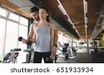 personal trainer helping woman... | Shutterstock . vector #651933934
