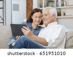 mature couple at home... | Shutterstock . vector #651951010