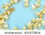 scattered salted popcorn ... | Shutterstock . vector #651973816