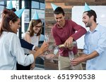 business executives pouring... | Shutterstock . vector #651990538