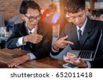 two young businessmen talk... | Shutterstock . vector #652011418