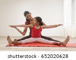 mother and daughter doing yoga... | Shutterstock . vector #652020628