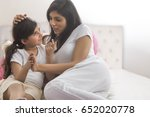mother talking to daughter in... | Shutterstock . vector #652020778