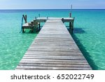wooden bridge in the sea... | Shutterstock . vector #652022749