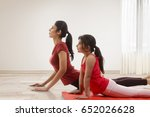 mother and daughter practicing... | Shutterstock . vector #652026628