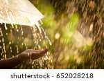 woman hand with umbrella in the ... | Shutterstock . vector #652028218