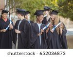 smiling graduate school kids... | Shutterstock . vector #652036873