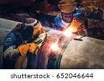 two welders are welding big... | Shutterstock . vector #652046644