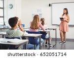 schoolgirl giving presentation... | Shutterstock . vector #652051714