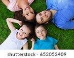 happy family outdoors  | Shutterstock . vector #652053409