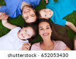 happy family outdoors  | Shutterstock . vector #652053430