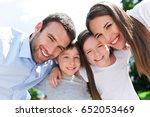happy family outdoors  | Shutterstock . vector #652053469