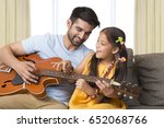 father and daughter singing... | Shutterstock . vector #652068766
