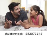 father and daughter lying on... | Shutterstock . vector #652073146