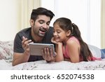 father and daughter using... | Shutterstock . vector #652074538