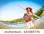 two young lovers on beach and... | Shutterstock . vector #652085770