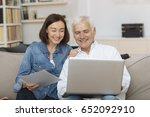 couple using their laptop to... | Shutterstock . vector #652092910