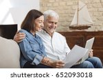 couple using their laptop to... | Shutterstock . vector #652093018