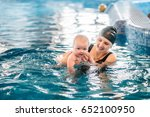 Young Mother  Swimming...