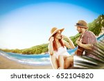 summer day on beach and two... | Shutterstock . vector #652104820