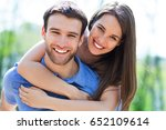 young couple hugging  | Shutterstock . vector #652109614