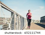 middle aged woman running... | Shutterstock . vector #652111744