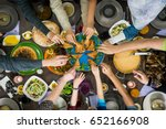 table of enjoying food with... | Shutterstock . vector #652166908