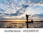 Silhouette Of Fishermen...
