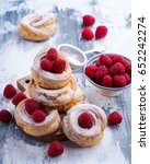 Small photo of Sweet eclair rings garnished with fresh raspberries
