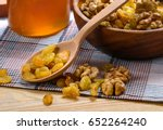 raisin and peeled walnuts with... | Shutterstock . vector #652264240