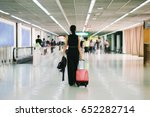 young woman pulling suitcase in ... | Shutterstock . vector #652282714