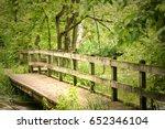 bridge over water in woods | Shutterstock . vector #652346104