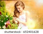 beauty girl outdoors enjoying... | Shutterstock . vector #652401628