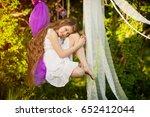 happy child girl on swing in ... | Shutterstock . vector #652412044