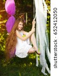 happy child girl on swing in ... | Shutterstock . vector #652412050