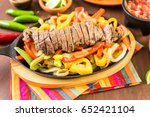 steak fajitas with bell peppers ... | Shutterstock . vector #652421104