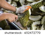 a man with knife is peeling the ... | Shutterstock . vector #652472770