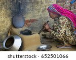 a rural woman blowing into a... | Shutterstock . vector #652501066