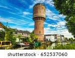 Old brick water tower in ancient European city of Utrecht, Netherlands