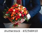 wedding bouquet of red flowers | Shutterstock . vector #652568410