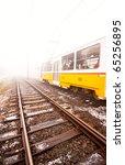 yellow tram in the fog | Shutterstock . vector #65256895