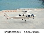 white helicopter lands on a... | Shutterstock . vector #652601008