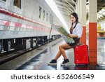 girl holding map  waiting for a ... | Shutterstock . vector #652606549