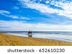 horsemen ride on beach water.... | Shutterstock . vector #652610230