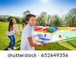 boy throwing balls up by using... | Shutterstock . vector #652649356