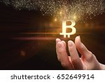 Small photo of Business woman with hands offers bit coin .