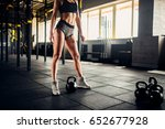 slim woman posing with weight... | Shutterstock . vector #652677928