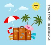 a suitcase with a palm tree on... | Shutterstock .eps vector #652817518