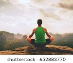 alone man is doing yoga pose on ... | Shutterstock . vector #652883770