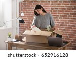 sad fired young employee... | Shutterstock . vector #652916128